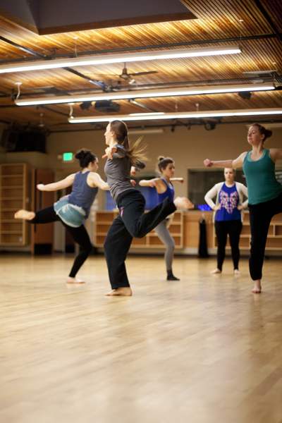 "Artistic Director Holly Logan observes the group rehearsing ""ODD Behaviors."" Also pictured (from left to right): Dancers CarliAnn Forthun, Jessica Mego, Madeline Cameron & Lindsay Johns.   Photo courtesy of  S. Weissbach Photography ."