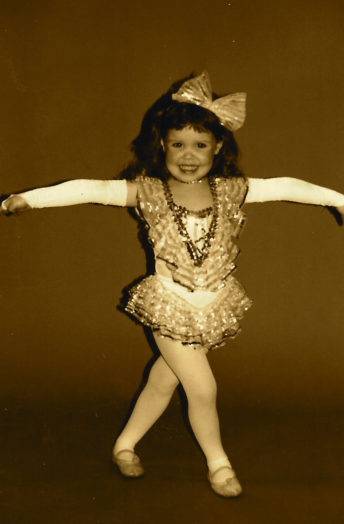 A photo of a young Heather Smith, vibrant & full of energy!