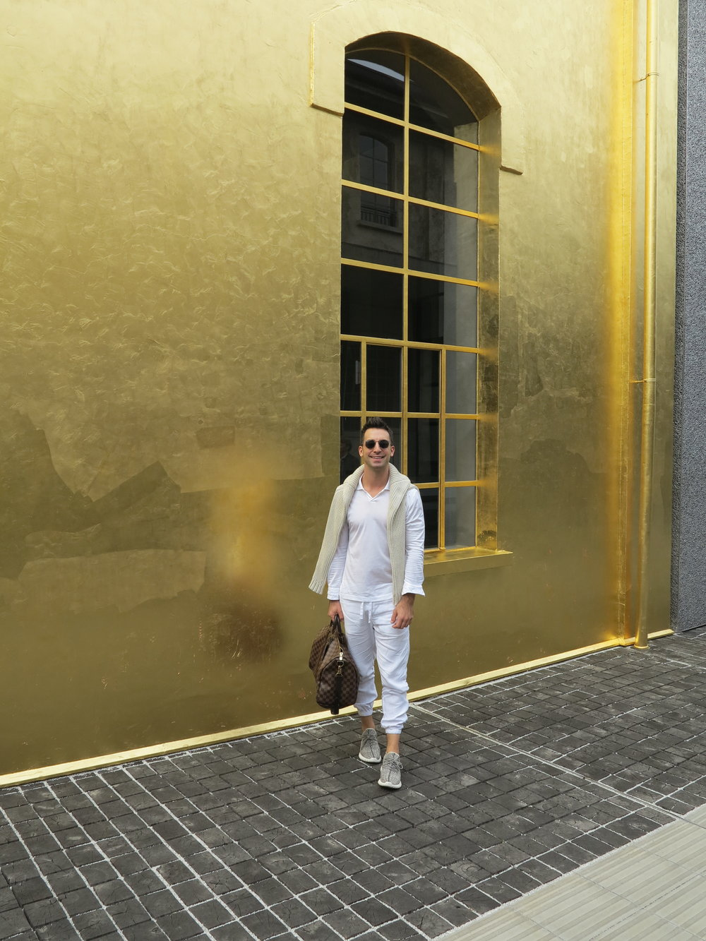 The iconic gold leaf building at Prada Fondazione.