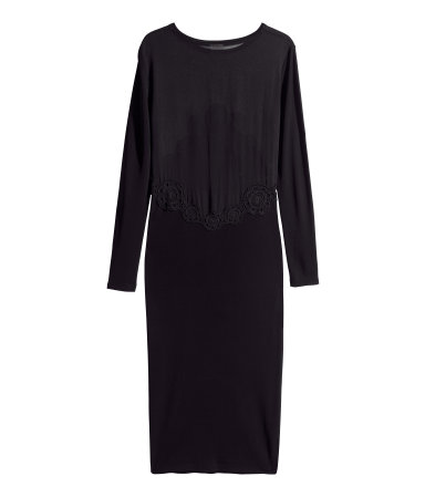 Ankle-length, long-sleeved dress with gently fitted, airy chiffon bodice and skirt and sleeves in slightly sheer jersey. Cotton lace trim at front and back. Gently tapered to hem. Unlined.