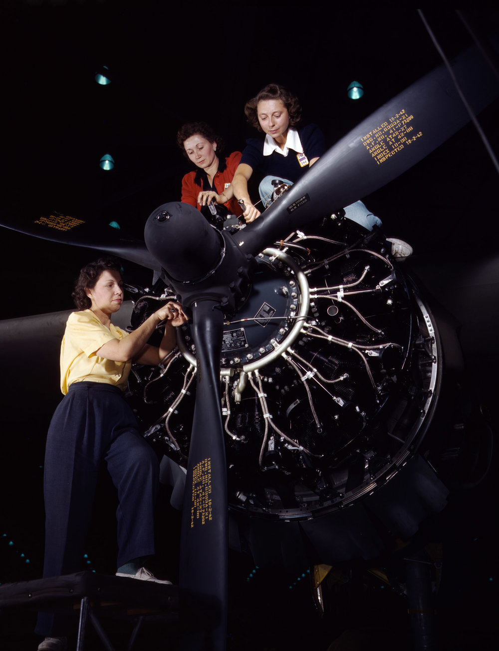 Precise engine installation duties at Douglas Aircraft Company, Long Beach, California. Photographer: Alfred T. Palmer