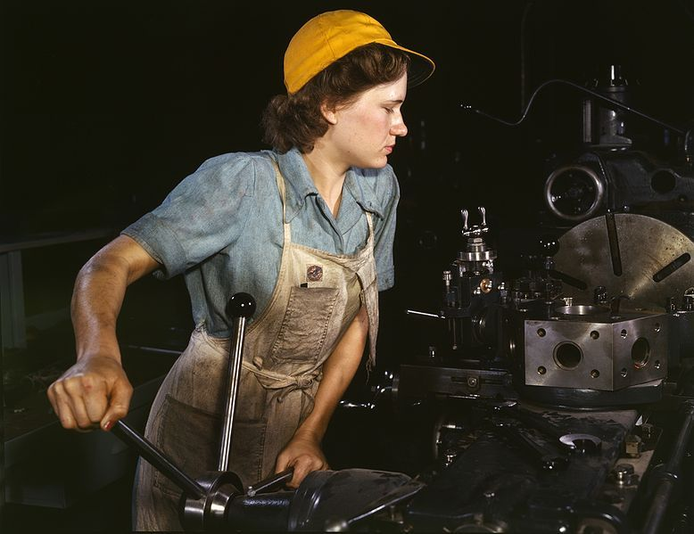 A woman operating a turret lathe (1942). Photographer: Howard R. Hollem