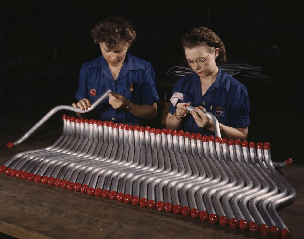 "Capping and inspecting tubing for the ""Vengeance"" A-31 dive bomber at Vultee plant, Nashville, Tennessee. Photographer: Alfred T. Palmer"