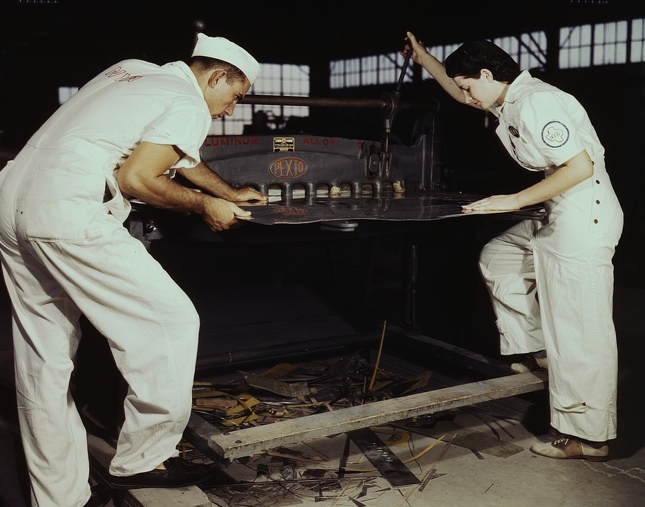 NYA employees learning to work a cutting machine at Corpus Christi, Texas. Photographer: Howard R. Hollem