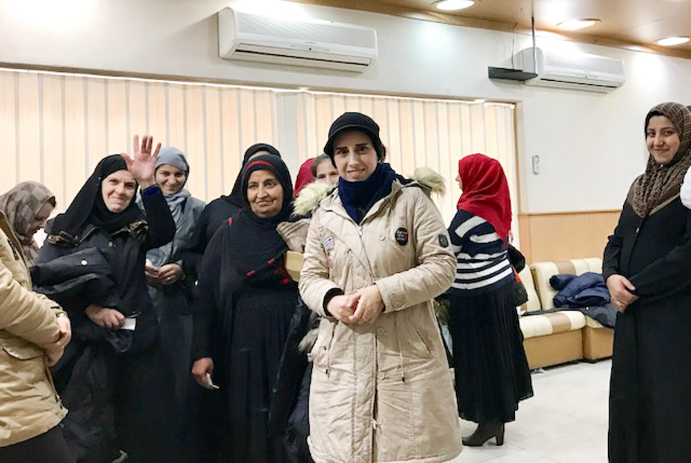 Refugee women at a different distribution center in Bekaa Valley