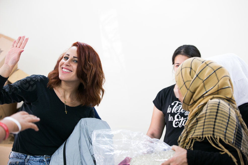 Local volunteer helps at the distribution center in Beirut
