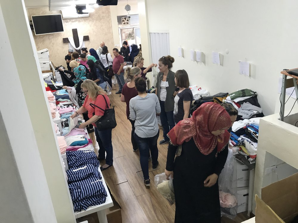 """Refugee women """"shop"""" for clothes for their families"""