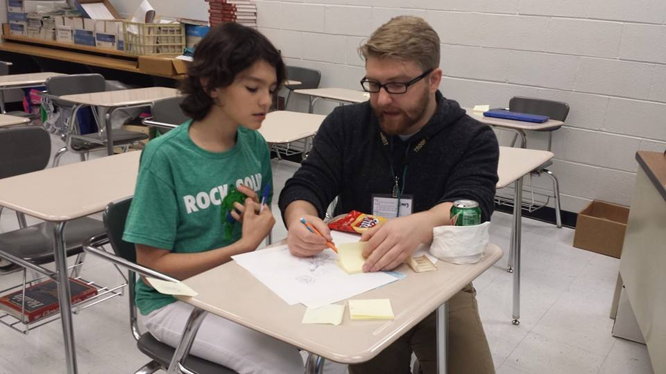 Jake Heagy helping a student during Star Wars Days.