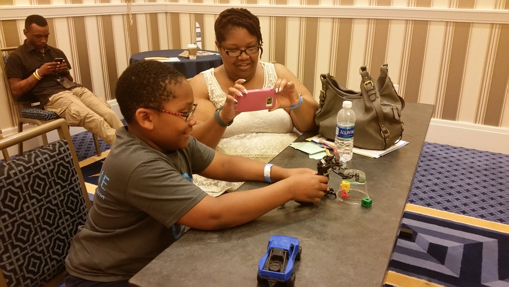 Ms. Rowland and her son participating in the stop motion workshop. You can see our own Donny Smoot in the background!