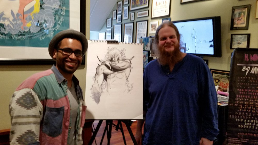Andrew Smart of  Call That Art  and his drawing of Luther Strode with writer Justin Jordan.