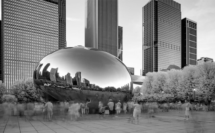 """A screenshot of the scene in the  NRA video  that uses Sir Anish Kapoor's """"Cloud Gate"""" for roughly a second. (screenshot by Hyperallergic)"""