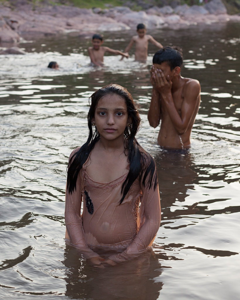 A girl playing in a river. Credit: Mahtab Hussain