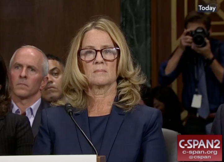 Dr. Christine Blasey before the US Senate. Image sourced from Wikipedia; originally from C-SPAN.