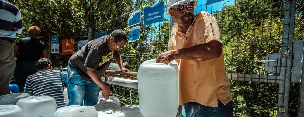 Cape Town residents queue to refill water bottles at Newlands Spring on January 31, 2018 in Cape Town, South Africa. Photo by Morgana Wingard/Getty Images