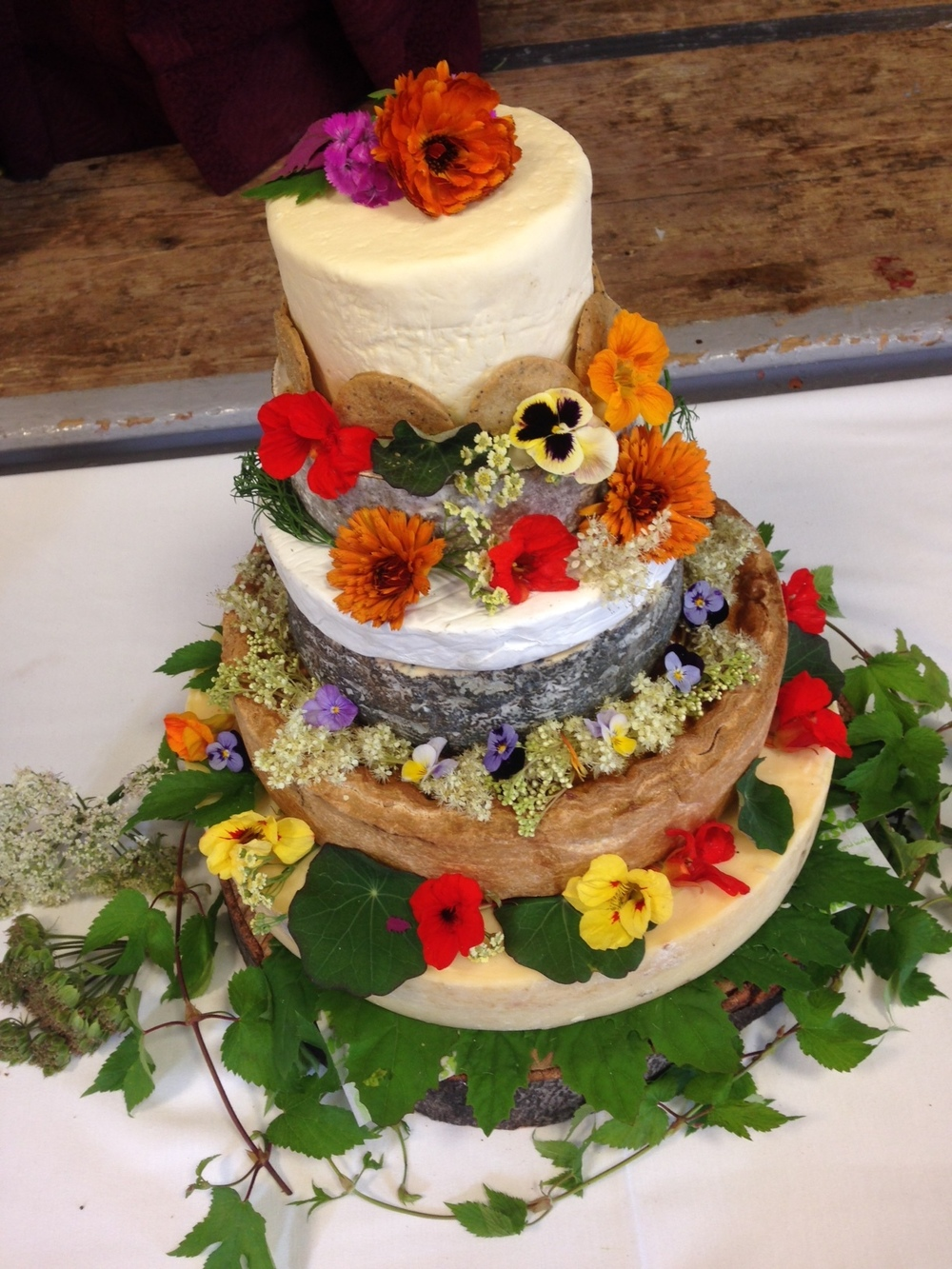 A Wedding Cake of Cheese (supplied by Reece at Urban Pantry) decorated with hop (dwarf variety Prima Donna), Marigold ,Viola, Nasturium, Borage and foraged Meadowsweet