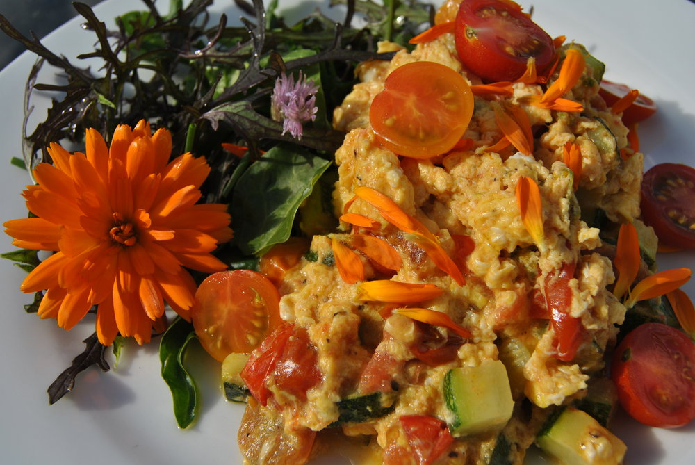 "Sunny scrambled eggs with garden vegetables and salad and Marigold ""petals"""