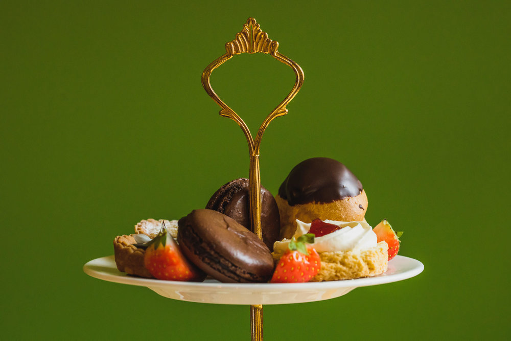 Afternoon tea by PJ taste with handmade macaroon, profiteroles, lemon tarts and scones