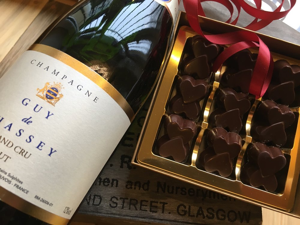Champagne and handmade chocolate truffles with a white chocolate and sloe gin centre