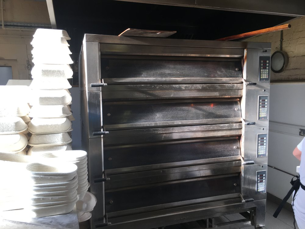 "The specialist ovens which create intense heat on their decks and inject steam to create ""oven lift"" essential the the final rise and crust quality."