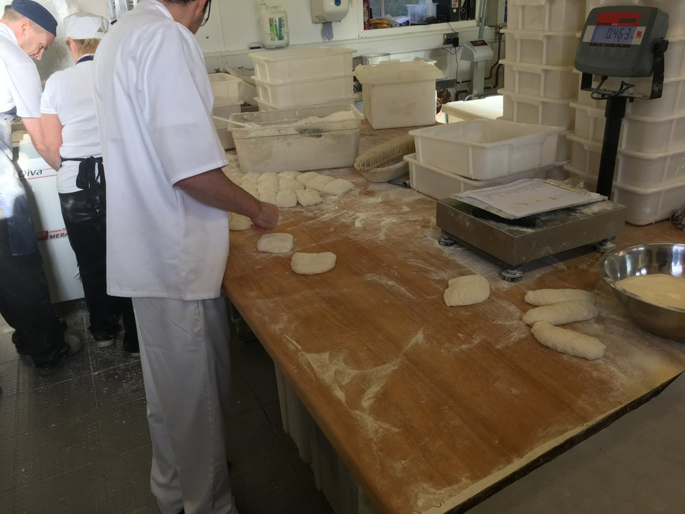 master baker Richard shaping dough for panini