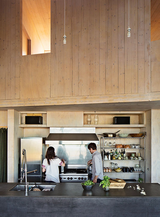 sailing_the_high_desert-prefab-vaction-home-kitchen-island-slate-steel-wolf-range.jpg
