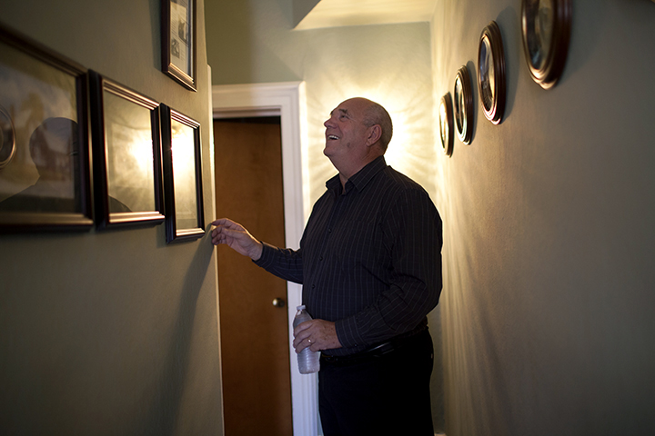 Town historian and city councilman, Mark Robinson in his home.
