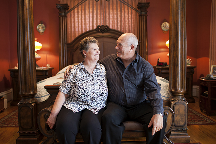 Mr. and Mrs. Robinson in their bedroom. Their home is the third oldest in Trenton.
