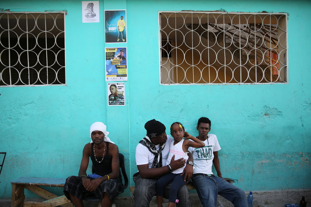 People of the Delmas 33 neighborhood in Port-au-Prince gathers for a wake organized by the deportee community.