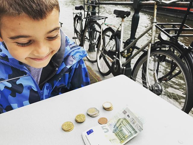 The kid has been collecting my change. I don't want to carry it.  22 euros so far... #lovemyboo