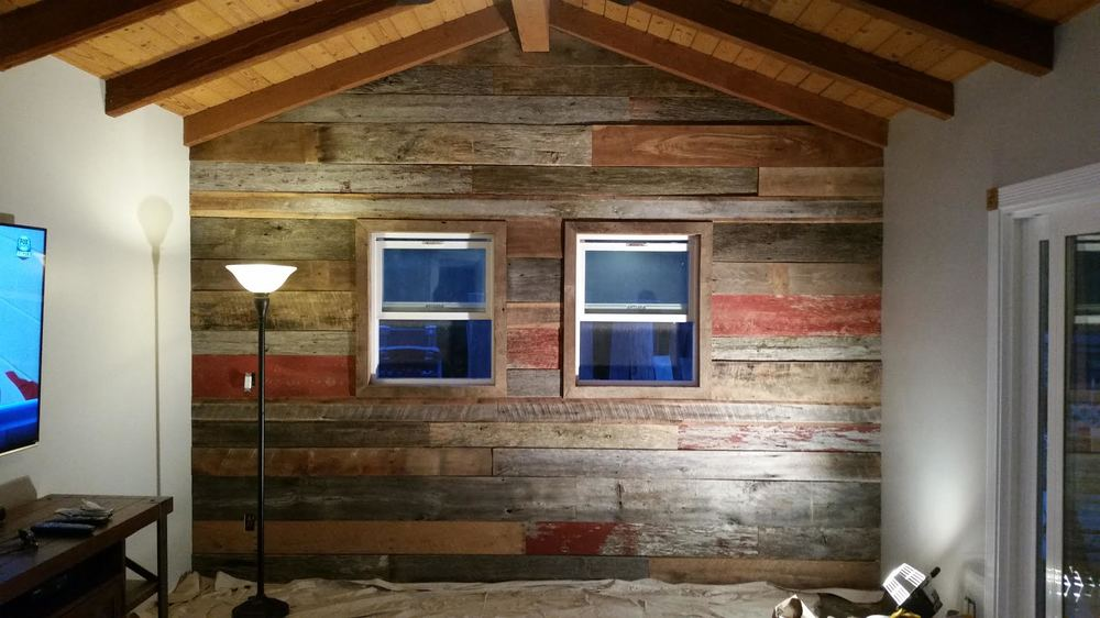 "Andrew Farmer of Farmer Construction & Plumbing sent us this  picture of the final result of all the mixed reclaimed wood he purchased from U.S. Reclaimed.  He came in with an idea for a wall for one of his clients, picked out some barn boards & created this beautiful accent wall with window casing.  ""Thank you all at US Reclaimed for your wonderful service to our family and your guidance through the picking out of your reclaimed barn siding in leading to such a beautiful wall within our home. It was a blast installing it and we are looking forward to the warm feel we get to experience on a daily basis.  We love it! Thanks again for all of your help!   Andrew and Nicolle Farmer""   """