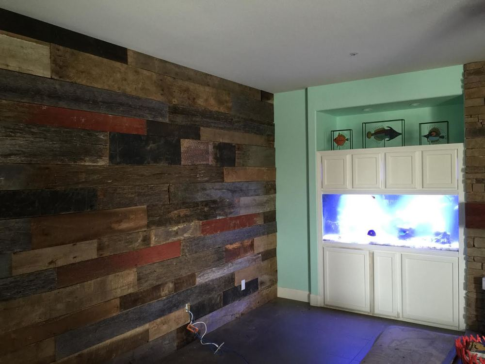 These customers came in on Saturday inquiring about doing an accent wall in their home with reclaimed wood barn boards.  They went home, took measurements of the wall , e-mailed them to us, we sent them over an estimate & contact info of 3 installers we refer to our customers for installation, they came in on Tuesday to select their wood & by the end of the day Wednesday their plain wall looked like this!  It is that simple to make any wall in your home a one of kind accent piece.