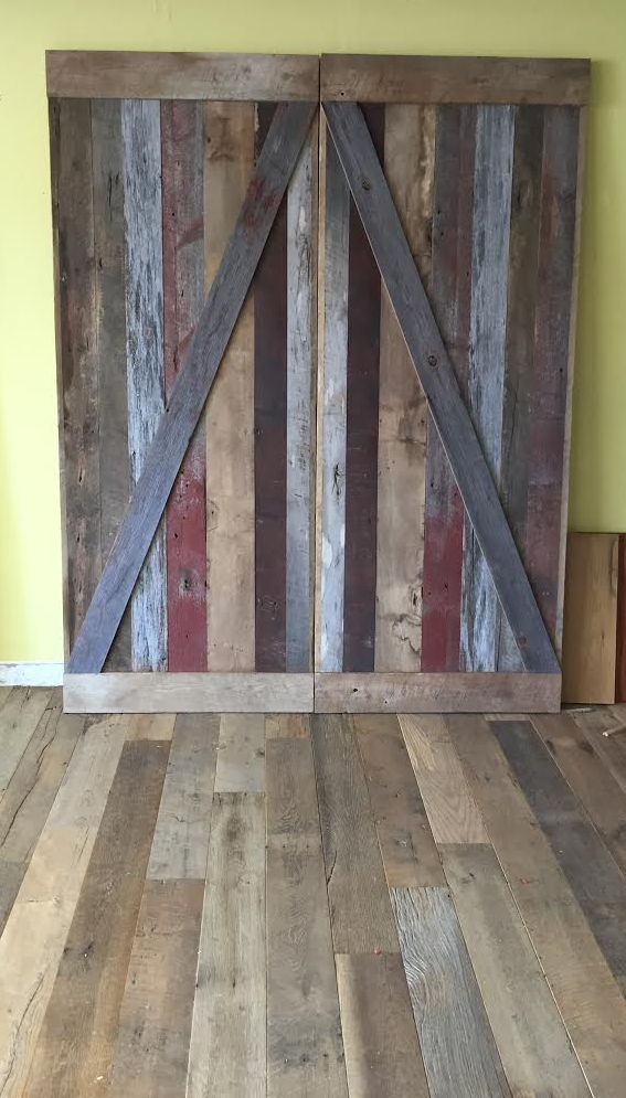 The finished product ready for pick up!  Our customer came in 4 weeks ago, discussed a design with Ben for doors for their walk in closet .  They picked out their pieces from our vintage lumber racks & chose some red patina barn board from our Michigan barn deconstruction to add a pop of color. They turned out beautifully & can't wait to see a pic of them installed in her home!