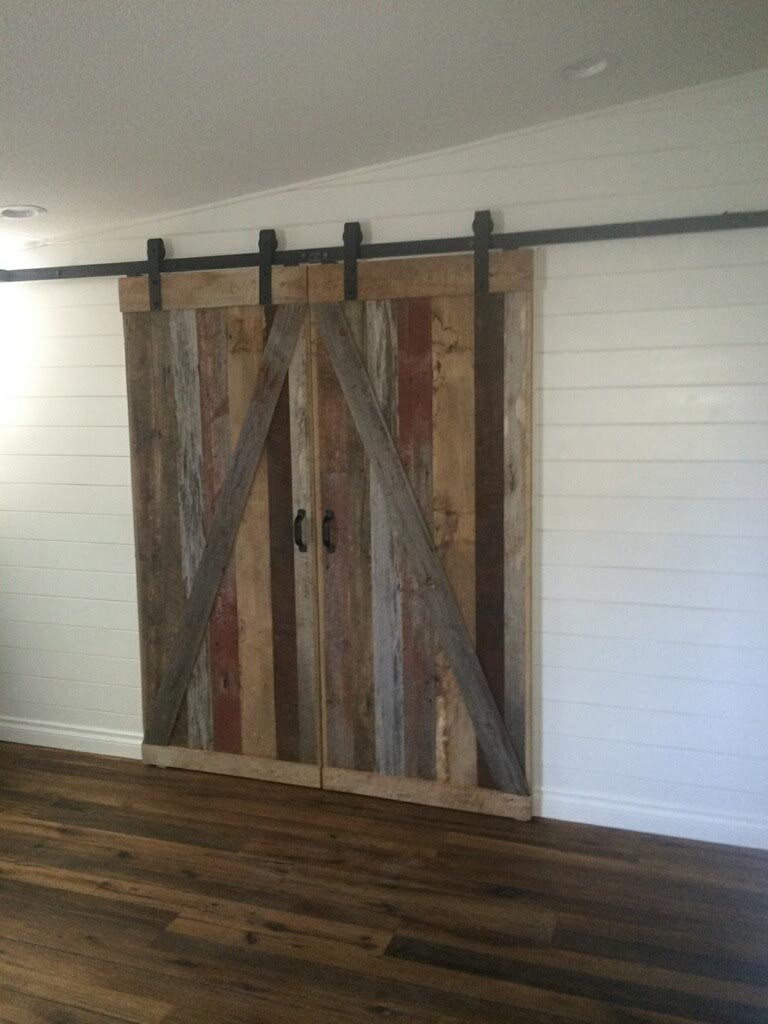 Here they are installed in their new homeas walk in closet doors! From our vintage lumber racks to our workshop where they were hand crafted to delivered & installed! These customers were so thrilled with how they turned out even better than they had imagined!