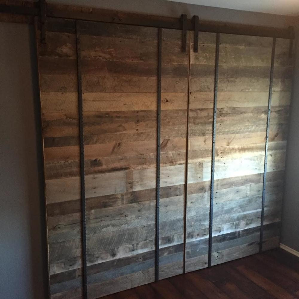 Here they are installed & hung! From our workshop at U.S. Reclaimed to their home as rolling track closet doors.  These custom designed & hand crafted reclaimed wood barn doors are the accent piece of this new bedroom remodel & our customers couldn't have been more pleased with the final product!