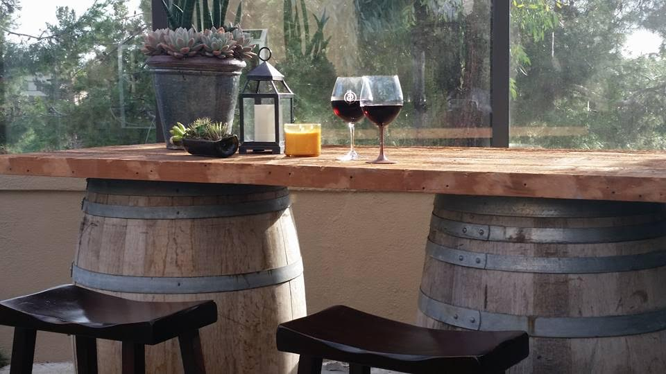 This customer had us join our vintage Doug Fir boards together to place on top of these 2 wine barrels he brought back from a winery in Napa, turning them into their very own outdoor wine bar!