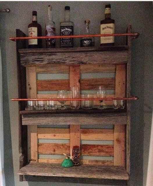 The awesome wall bar Ben helped me make for my husbands bday. Reclaimed grey wood from his shop. Came out badass. - Megan B.