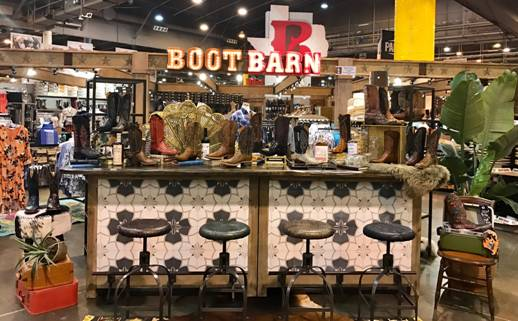 This reclaimed wood bar top at Boot Barn is a perfect fit!