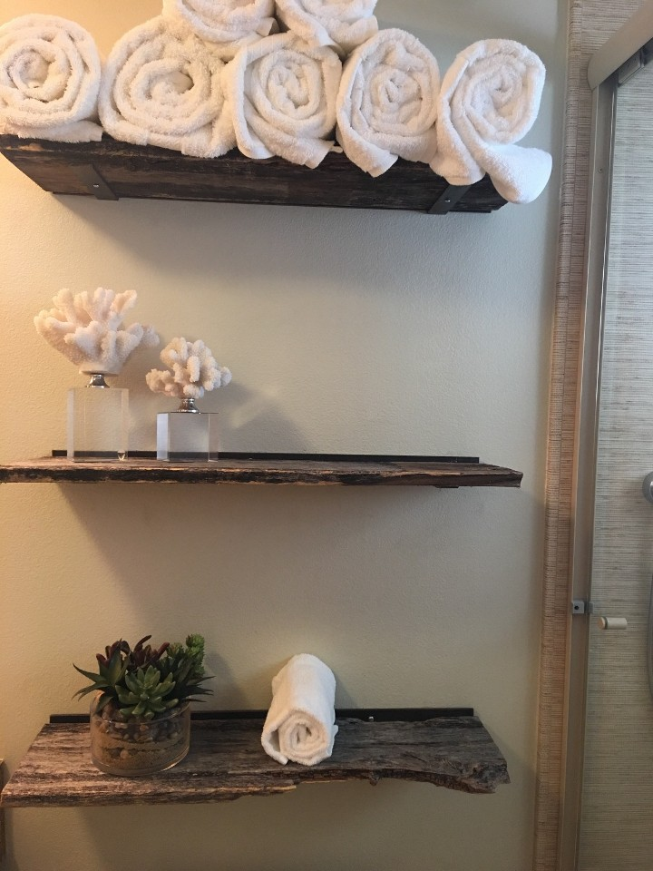 Shelving is a useful and beautiful way to use reclaimed wood pieces.
