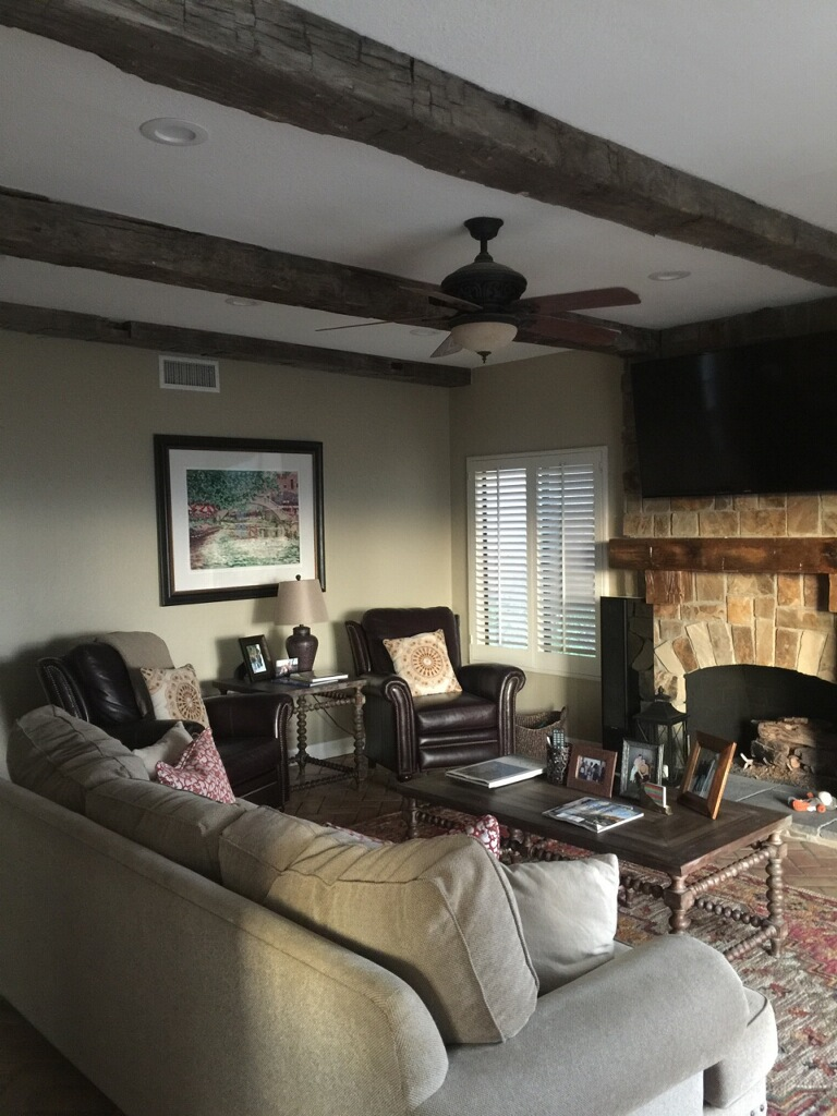 Reclaimed wood beams are a conversation piece filled with history for the entertainment area.
