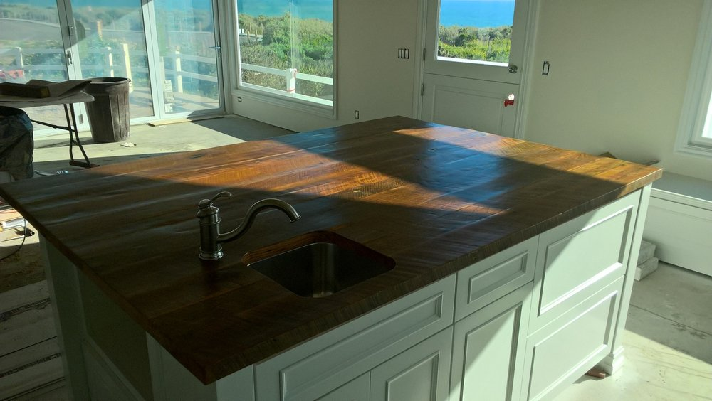 Impressive and custom built reclaimed wood kitchen island.