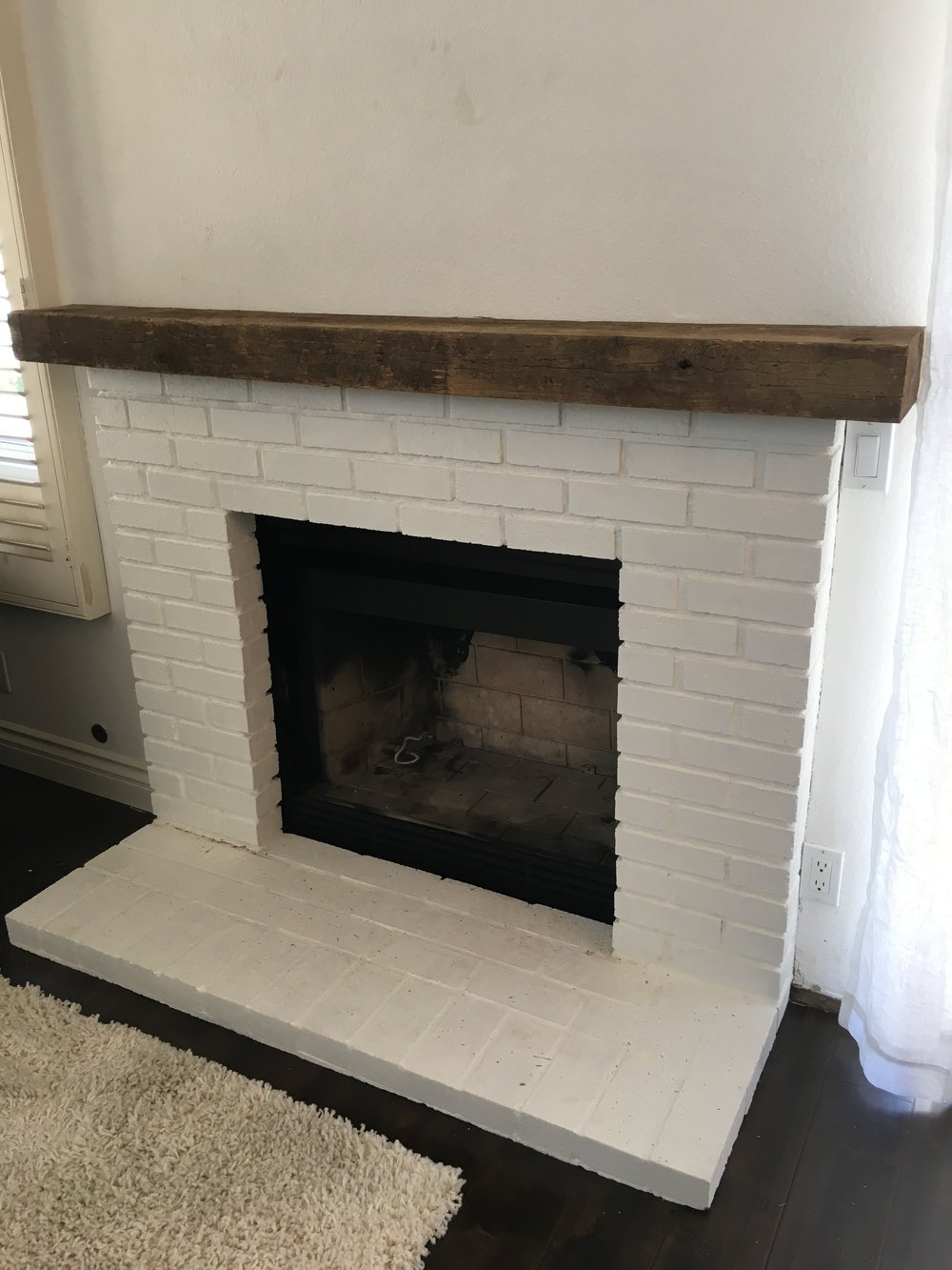 U.S. Reclaimed beam used to create a beautiful mantel piece.