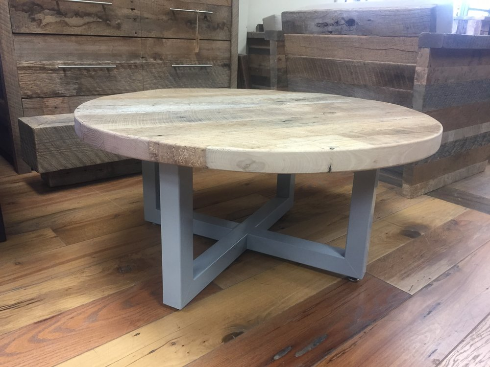 Solid reclaimed wood table top finished with a sleek metal base.