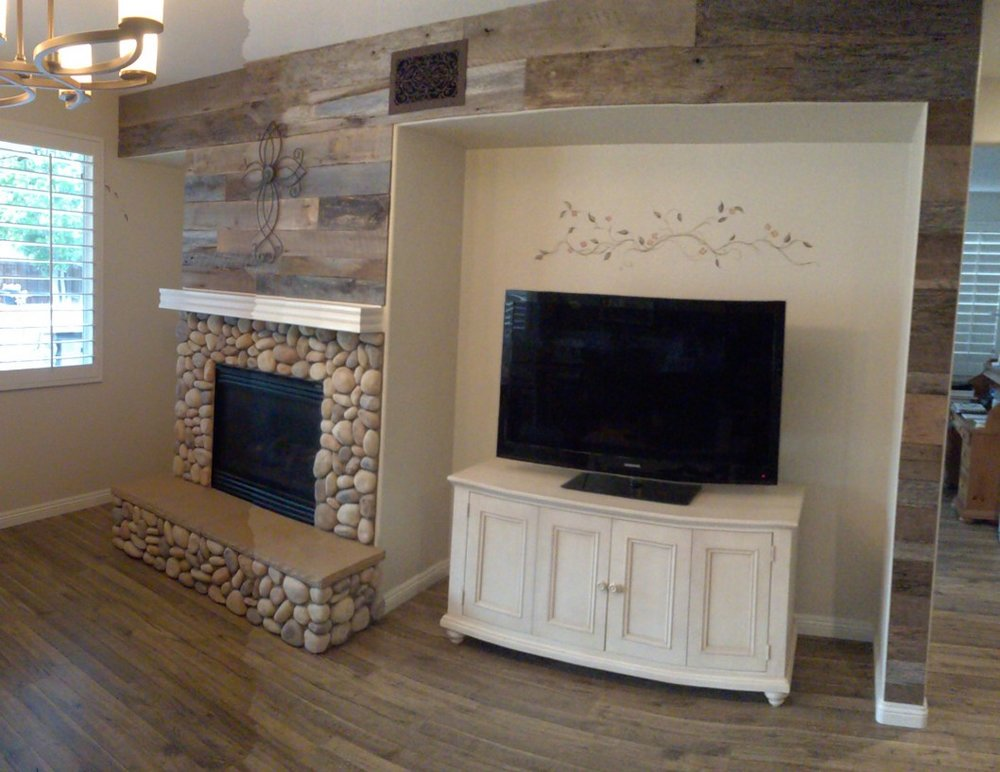 Vintage paneling adds wonderful charm to this entertainment room. The paneling consists of United States reclaimed wood. Each reclaimed piece of wood is unique in detail and has been aged to perfection. Find the perfect paneling at U.S. Reclaimed Vintage Lumber & Wood Works.