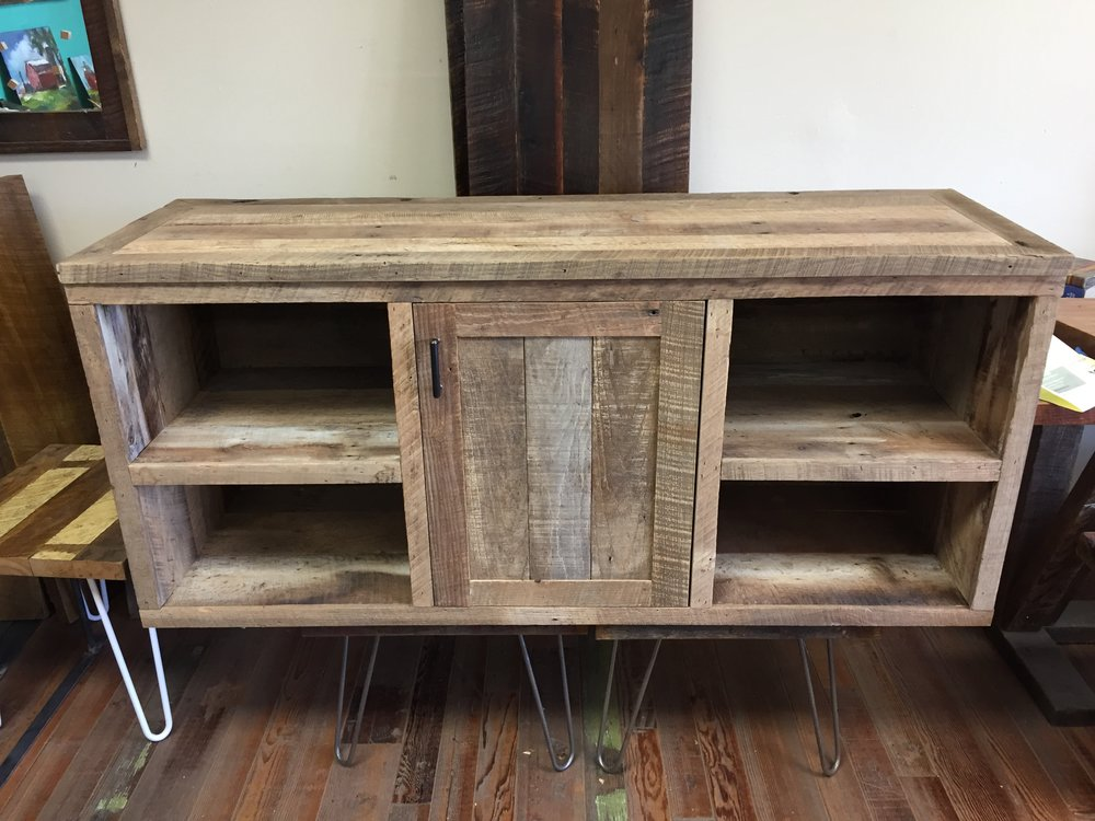 U.S. Reclaimed, Vintage Lumber & Wood Works specializes in custom designs and builds. The entertainment unit pictured above is a recent custom furniture build using our reclaimed vintage lumber. Entertainment centers, and all furniture, are designed and built based on the customers desires. Contact or visit our store today to get started on a custom piece of furniture.