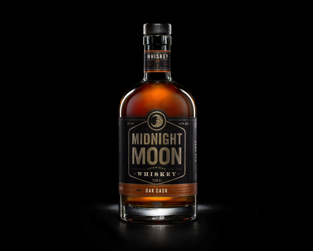 Foils and metallics, polished colors and premium paper give Midnight Moon Whiskey premium cachet.