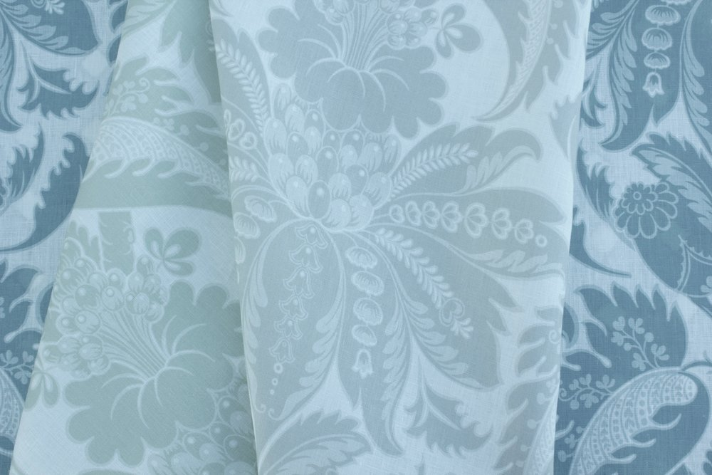 """Venetian Damask"" is a classic that has been reintroduced in soft new colorways and printed on a crisp, white linen."