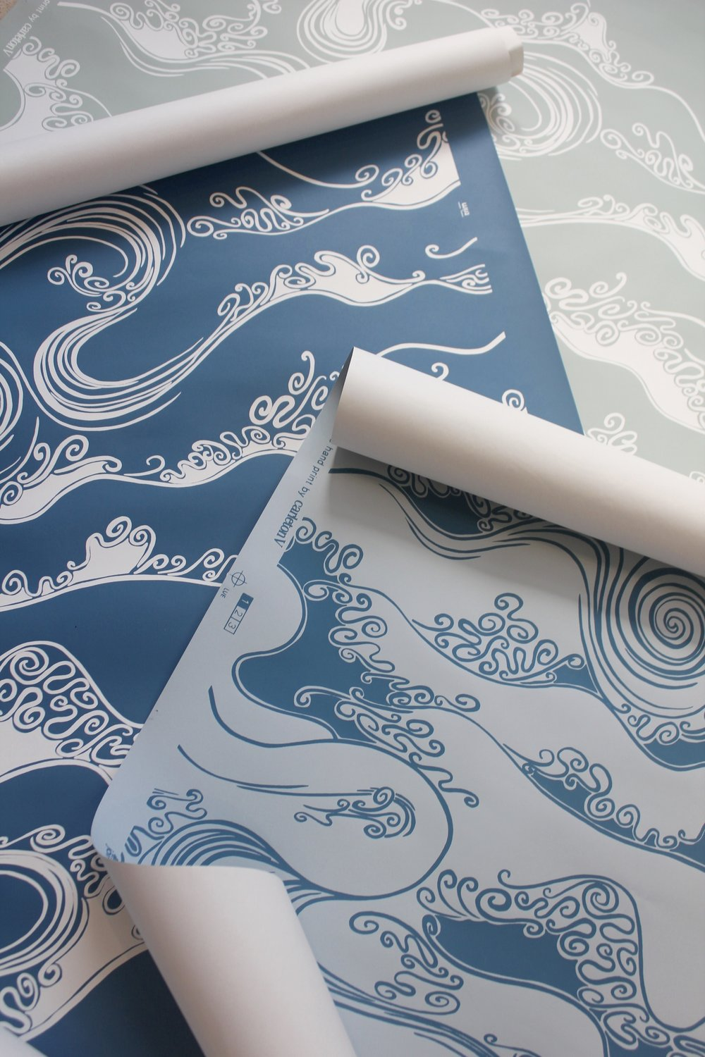 Kauai  This stylized wave wallcovering is offered in 3 ocean inspired colorways.
