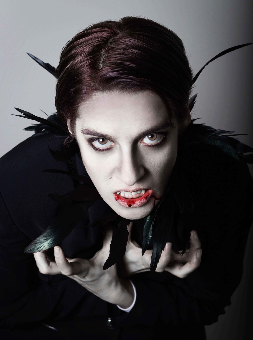 portrait of a young woman in vampire makeup