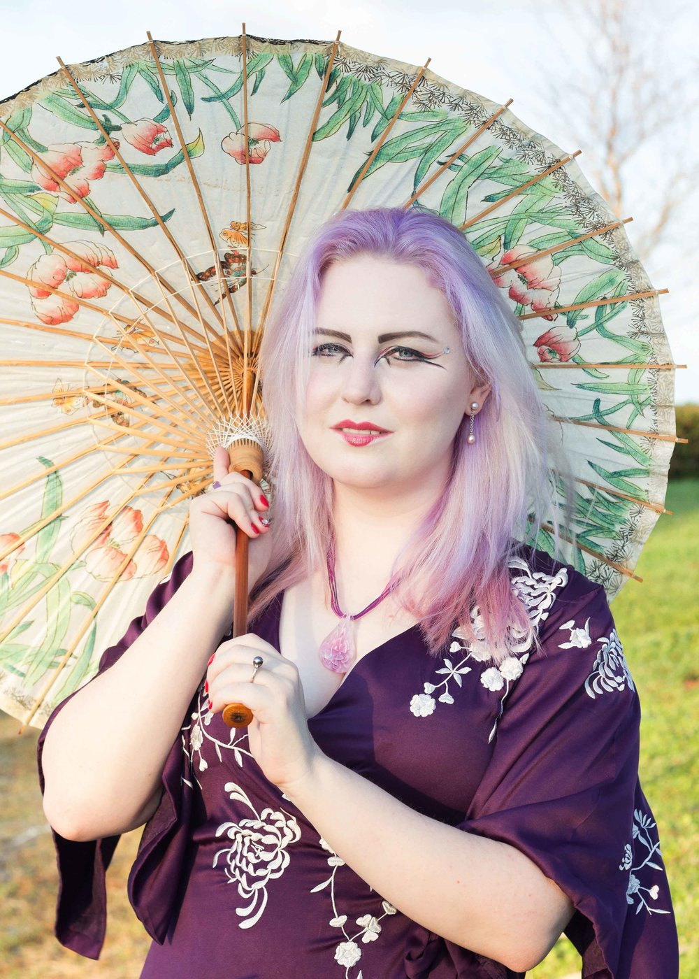 girl in purple kimono dress holding asian umbrella