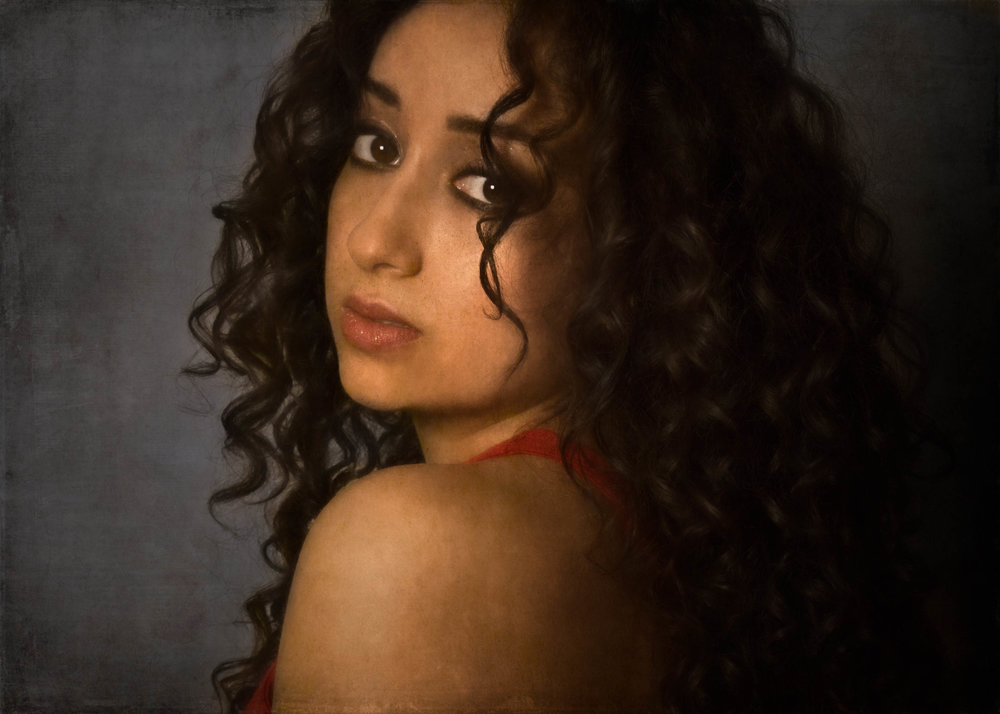 portrait of a young girl with black curly hair